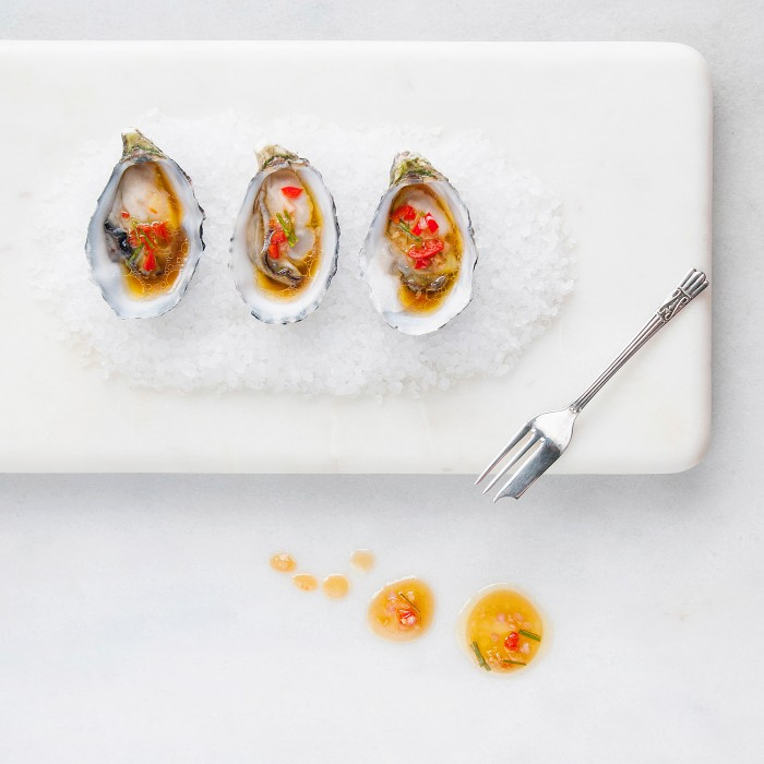 Asian Inspired Oysters on a bed of rock salt